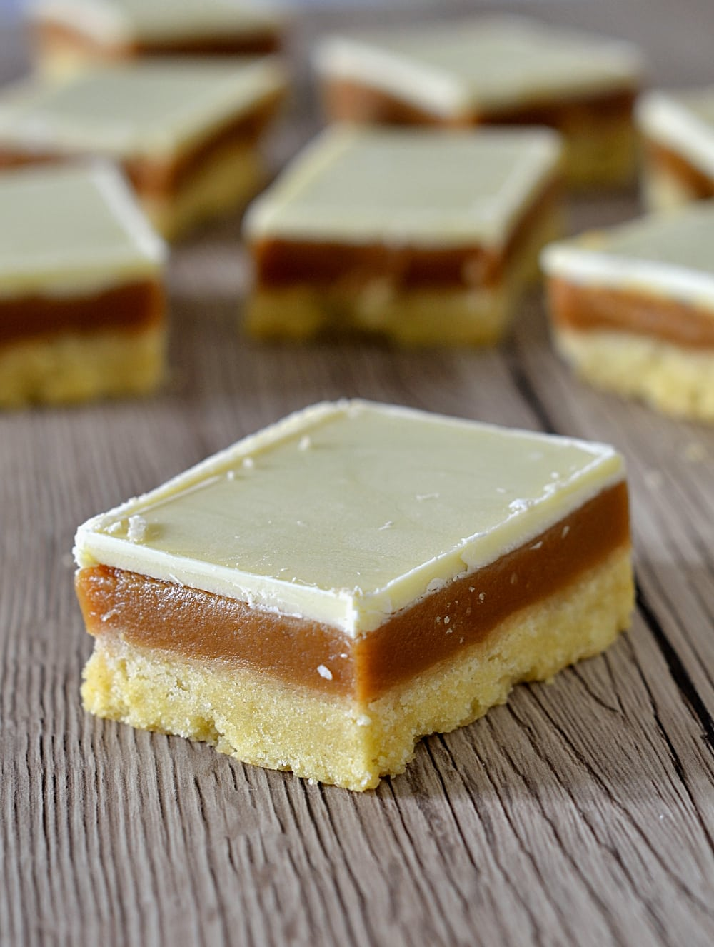 Caramel Slice Recipe - Baking with Granny. Also known as Caramel Shortcake and Millionaires Slice. The traditional Scottish tray bake with a biscuit base, layer of caramel and topped with chocolate.