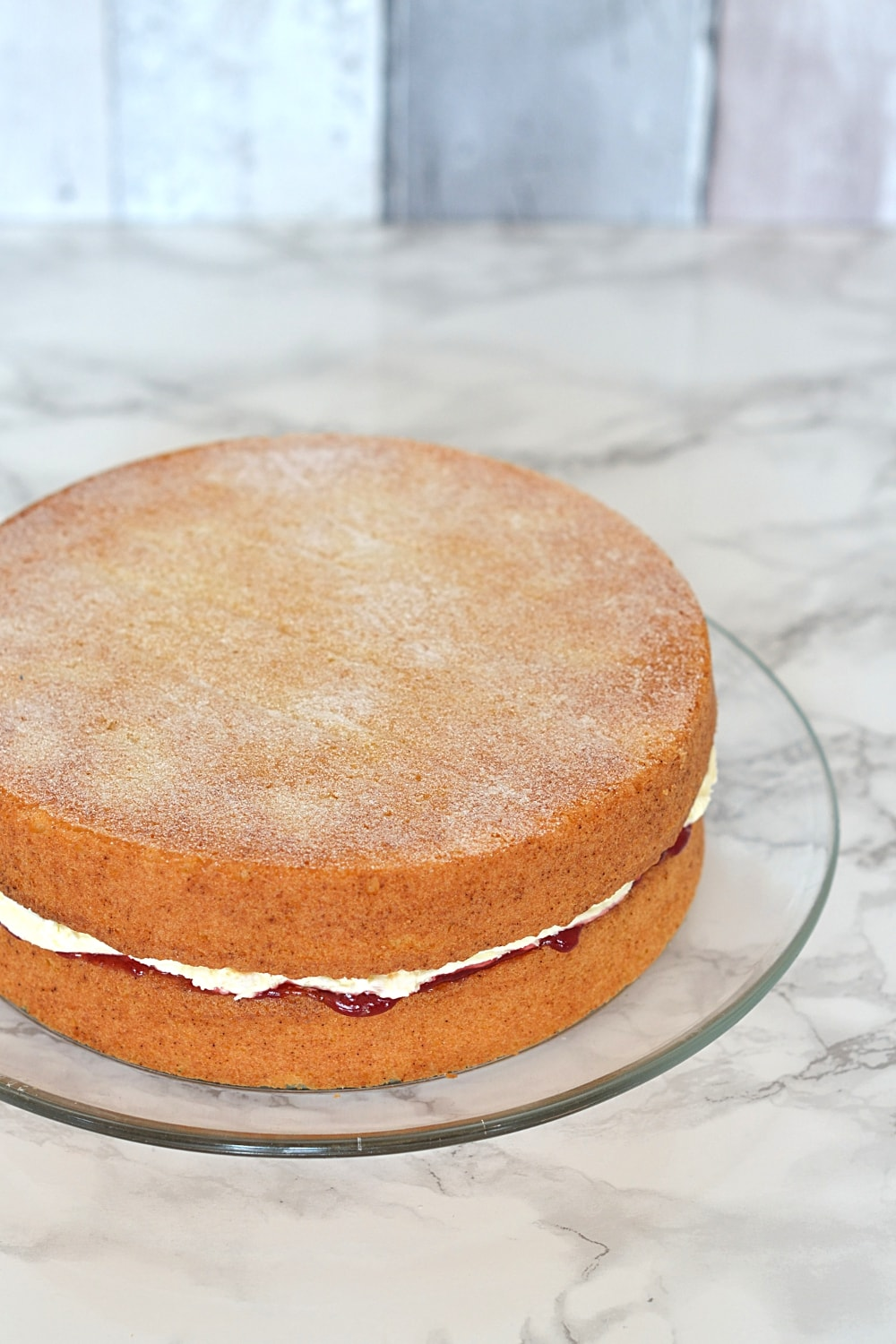 Classic Victoria Sponge recipe from Baking with Granny. Plain sponge with raspberry jam; cream optional.