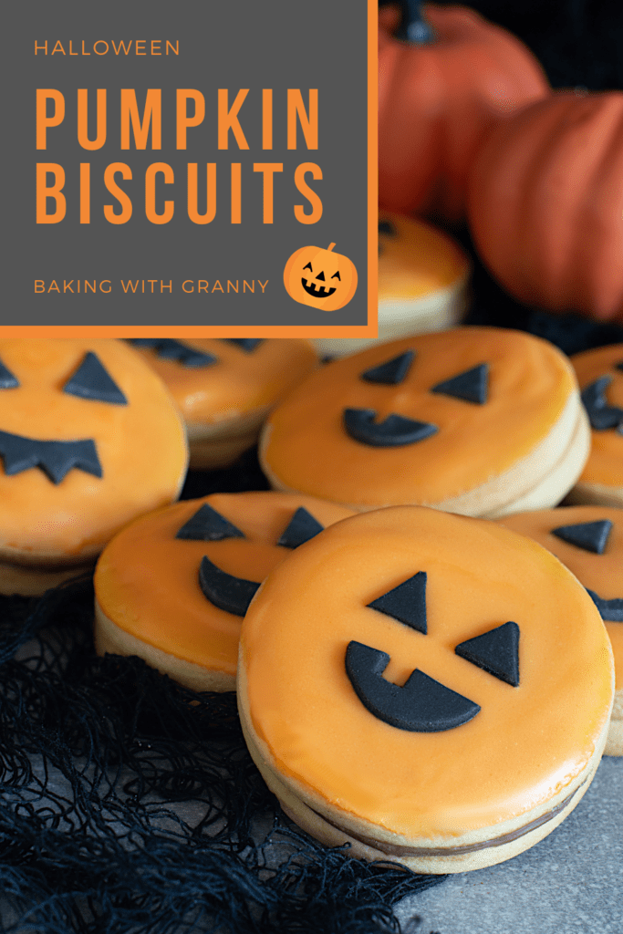 Pumpkin Biscuits recipe from Baking with Granny. Traditional Empire Biscuits, filled with chocolate and decorated to look like little pumpkin faces.